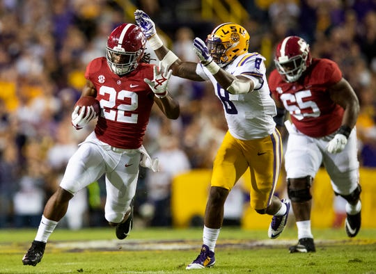 Alabama running back Najee Harris (22) eludes Louisiana State University linebacker Patrick Queen (8) in first half action at Tiger Stadium in Baton Rouge, La., on Saturday November 3, 2018.