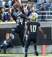 Alabama State defensive back Joshua Hill (24) intercepts a pass intended for Texas Southern wide receiver Tren'Davian Dickson (11) in the end zone Saturday, Nov. 3, 2018, at Alabama State University in Montgomery, Ala.