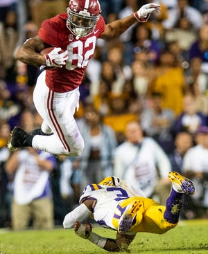 Alabama tight end Irv Smith Jr. (82) is upended by Louisiana State University safety Todd Harris, Jr., (33) in second half action at Tiger Stadium in Baton Rouge, La., on Saturday November 3, 2018.