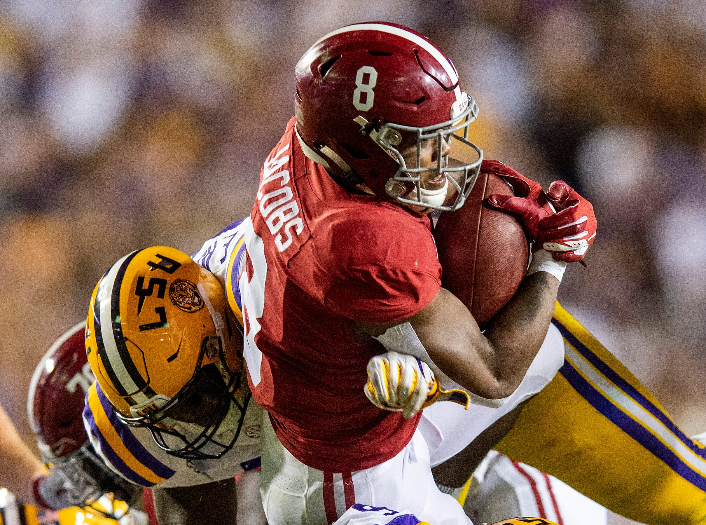 Alabama running back Josh Jacobs (8) makes a first down on a fourth down run against Louisiana State University in first half action at Tiger Stadium in Baton Rouge, La., on Saturday November 3, 2018.