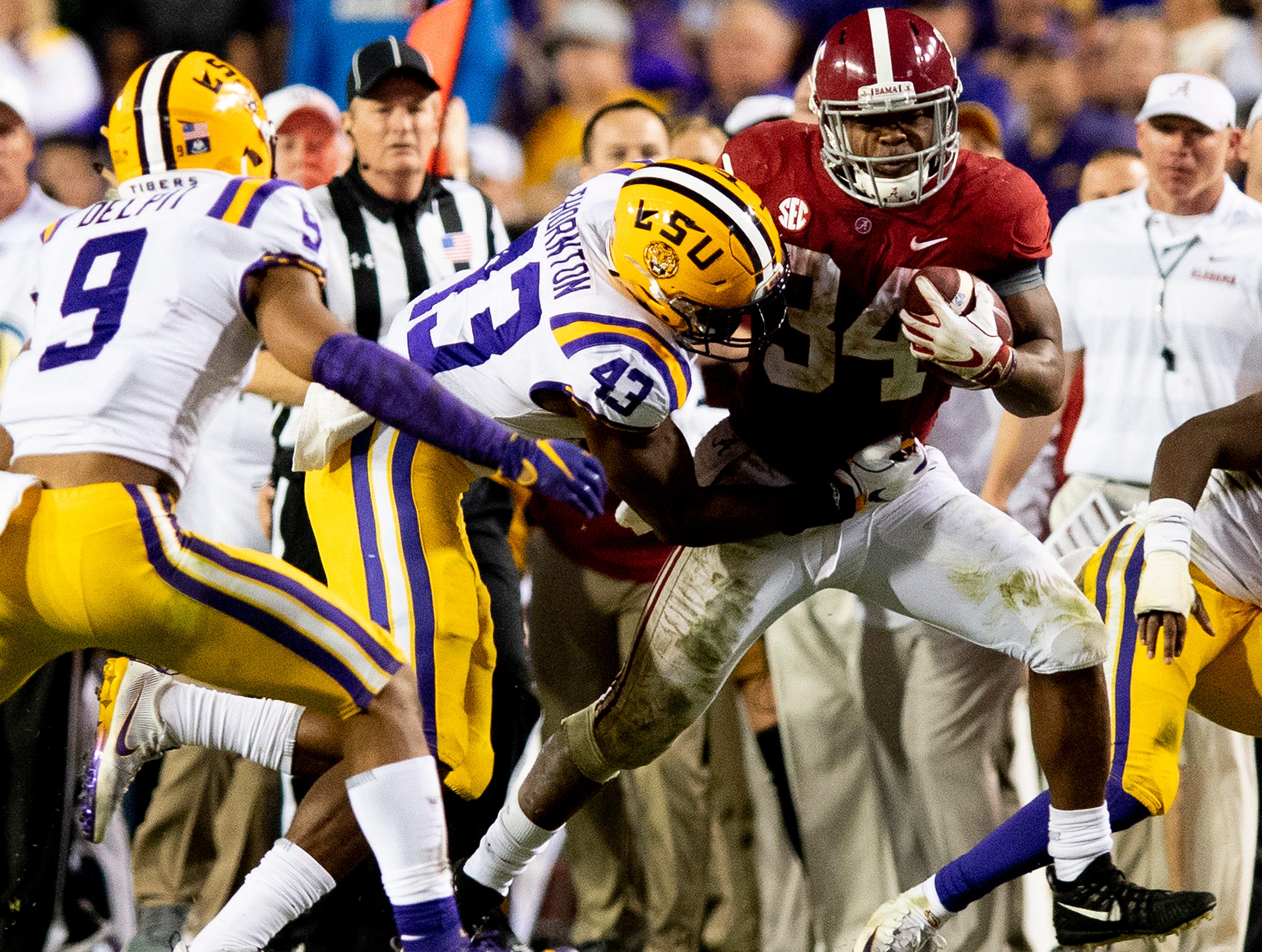 Alabama running back Damien Harris (34) carries the ball against LSU in second half action at Tiger Stadium in Baton Rouge, La., on Saturday November 3, 2018.