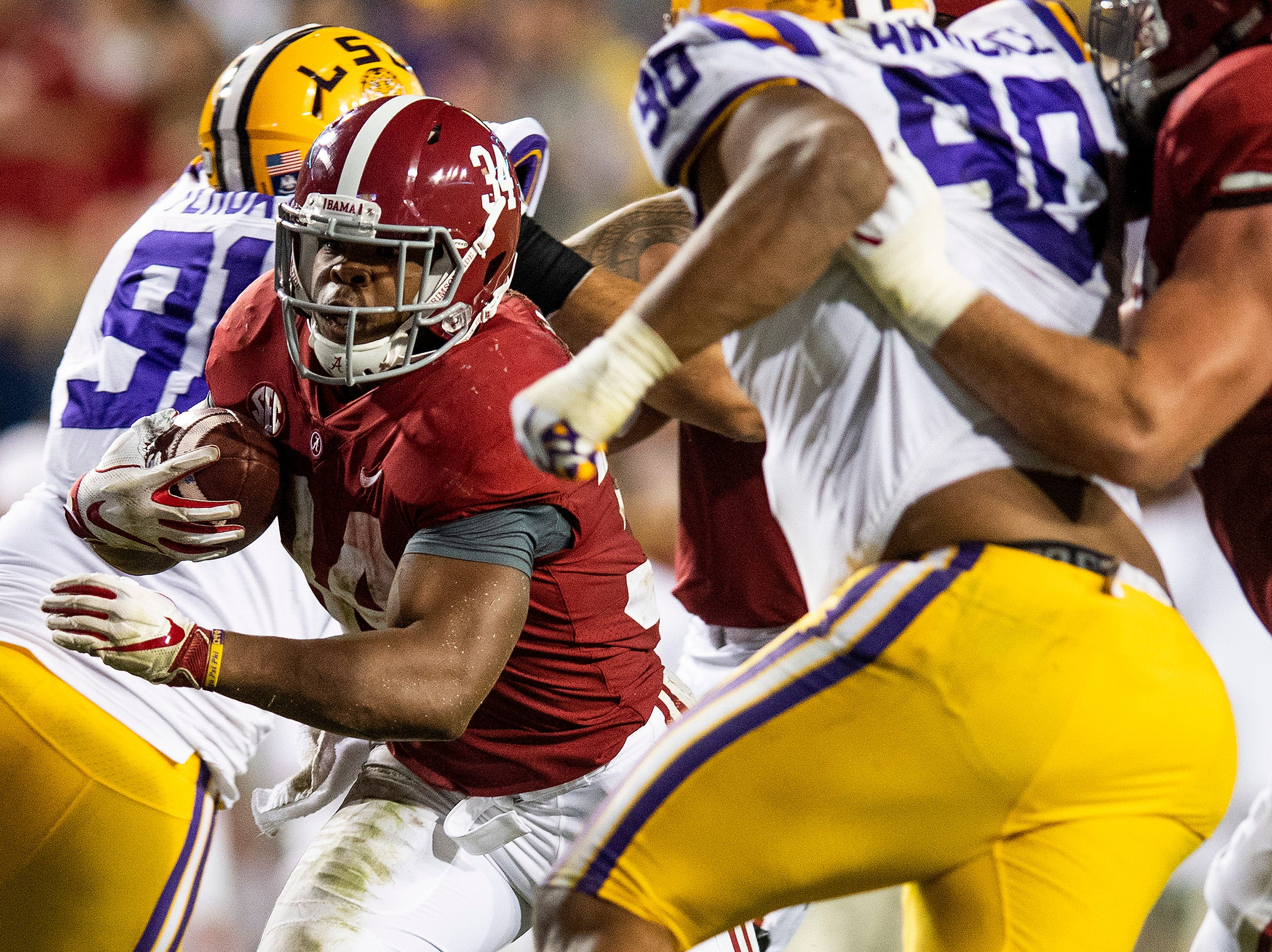 Alabama running back Damien Harris (34) carries against LSU in second half action at Tiger Stadium in Baton Rouge, La., on Saturday November 3, 2018.