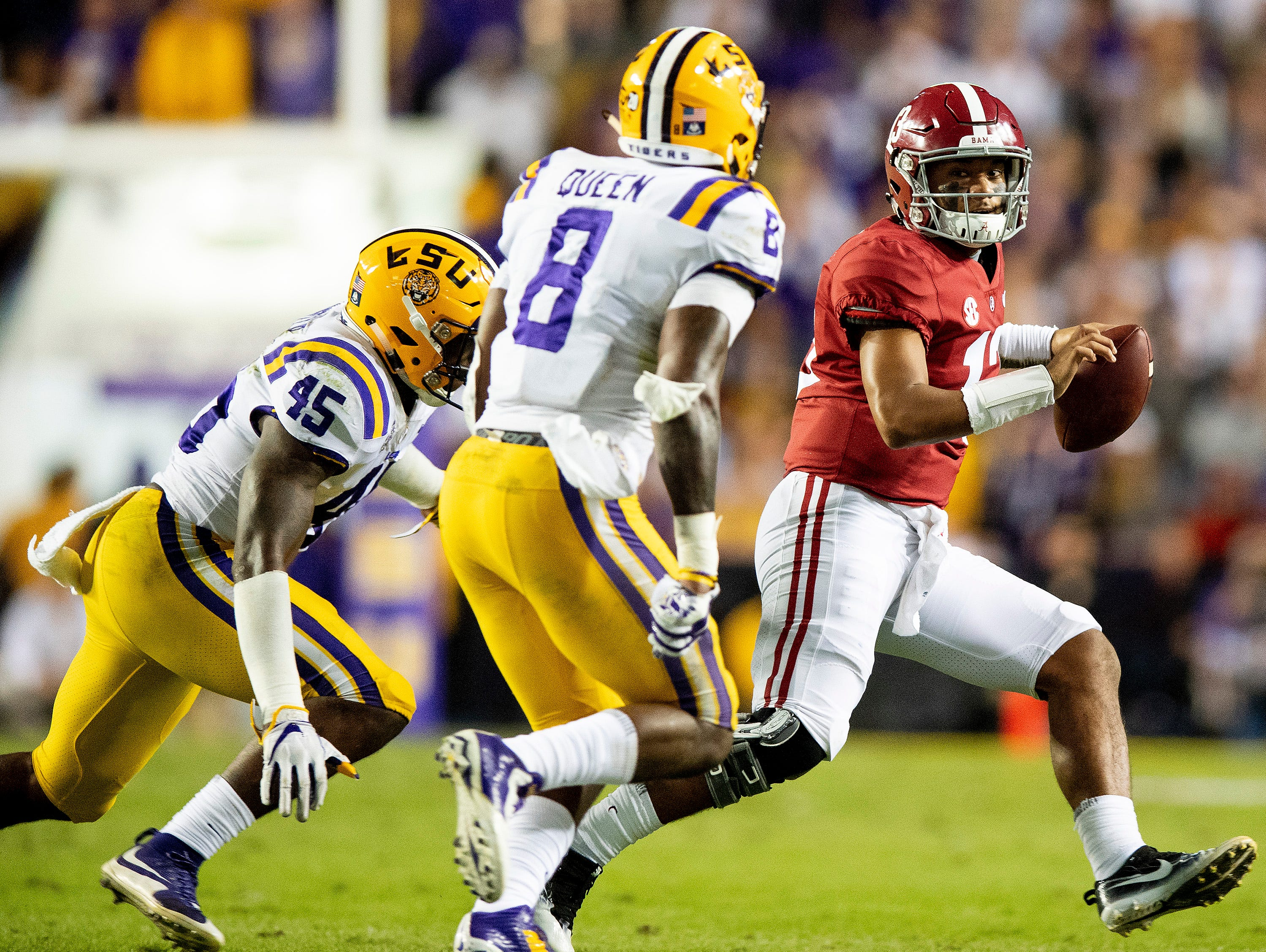 Alabama quarterback Tua Tagovailoa (13) scrambles against Louisiana State University in first half action at Tiger Stadium in Baton Rouge, La., on Saturday November 3, 2018.