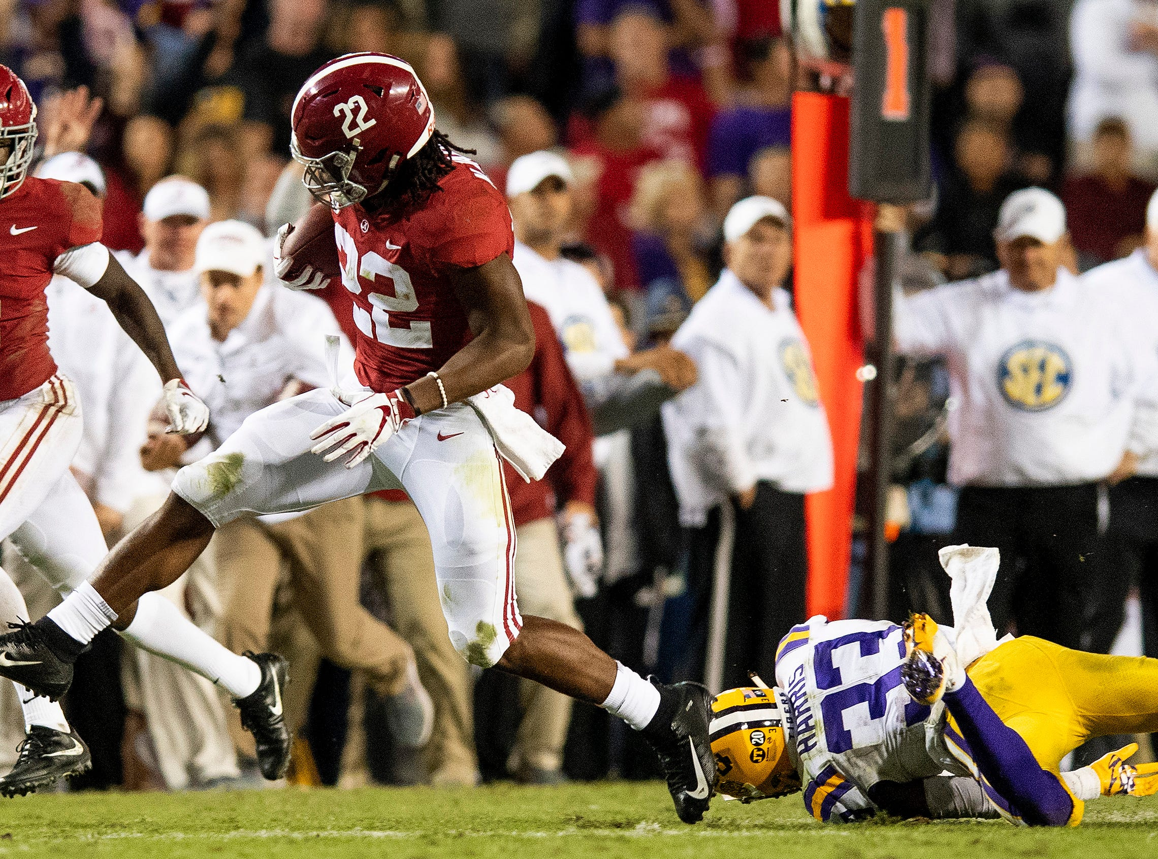 Alabama running back Najee Harris (22) gets by Louisiana State University safety Todd Harris, Jr., (33) in second half action at Tiger Stadium in Baton Rouge, La., on Saturday November 3, 2018.