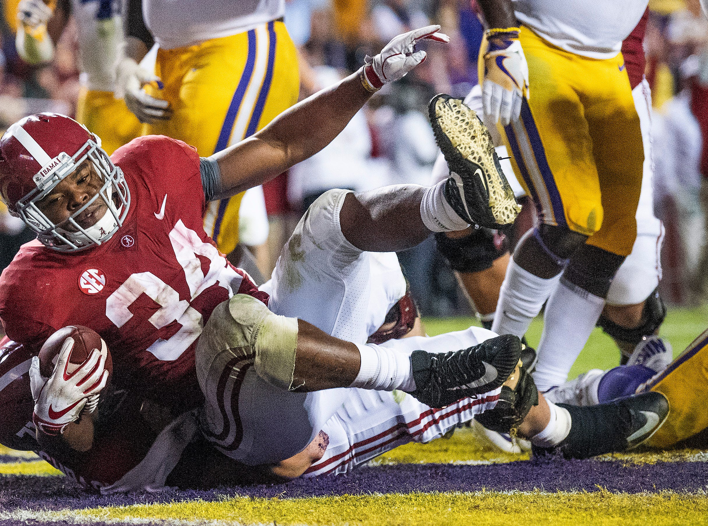 Alabama running back Damien Harris (34) scores a touchdown against Louisiana State University in second half action at Tiger Stadium in Baton Rouge, La., on Saturday November 3, 2018.