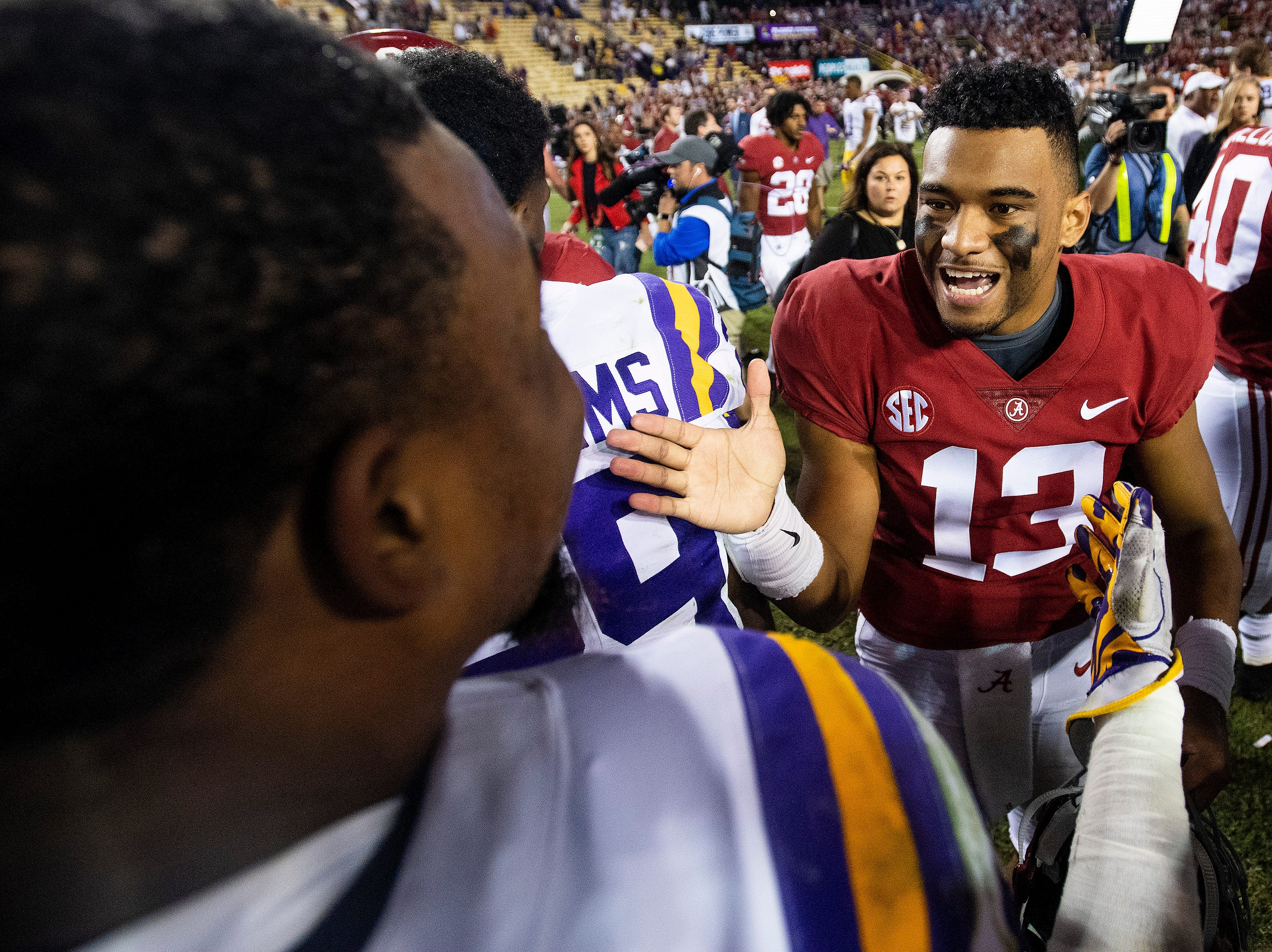 Alabama quarterback Tua Tagovailoa (13) greets Louisiana State University outside linebacker Michael Divinity, Jr., (45) after defeating LSU at Tiger Stadium in Baton Rouge, La., on Saturday November 3, 2018.