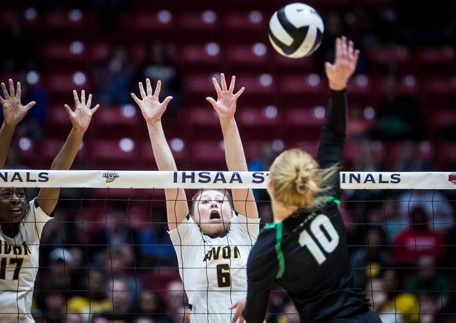 Avon's Abby Maesch jumps for a block against Yorktown during their state final game at Worthen Arena Saturday, Nov. 3, 2018.