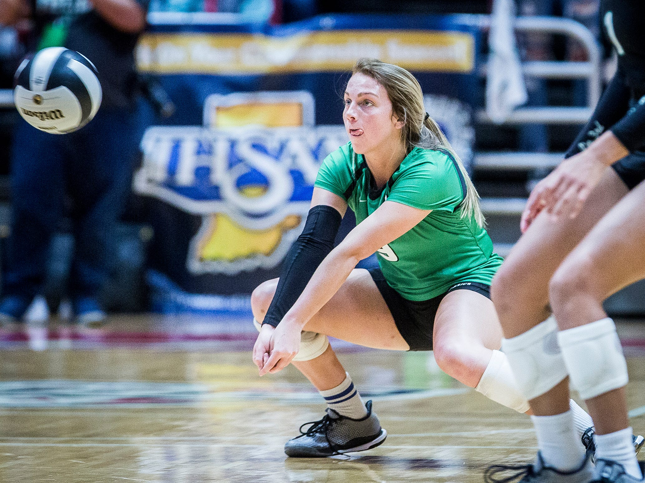 Yorktown's Kylie Murr digs a ball in the state championship match. Murr was one of three Tigers that made all-state.