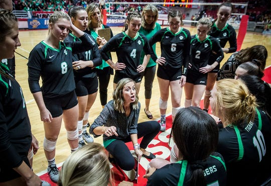 FILE -- Yorktown volleyball coach Stephanie Bloom talks with her team during the Tigers' state championship win over Avon in 2018. Yorktown swept Avon in a rematch this weekend.