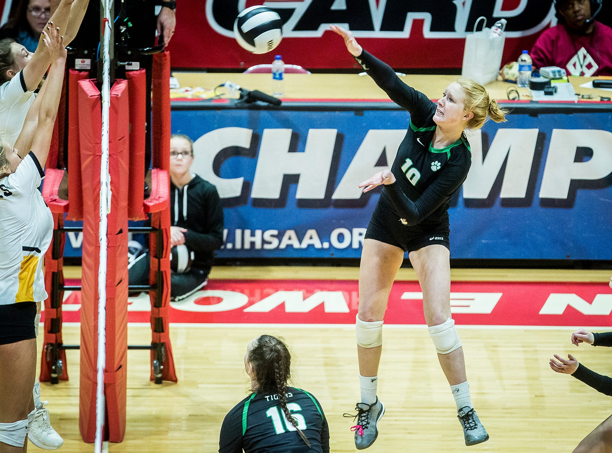 Yorktown's Tegan Seyring hits against Avon's defense in the state championship match. Seyring was one of three Tigers that made all-state.
