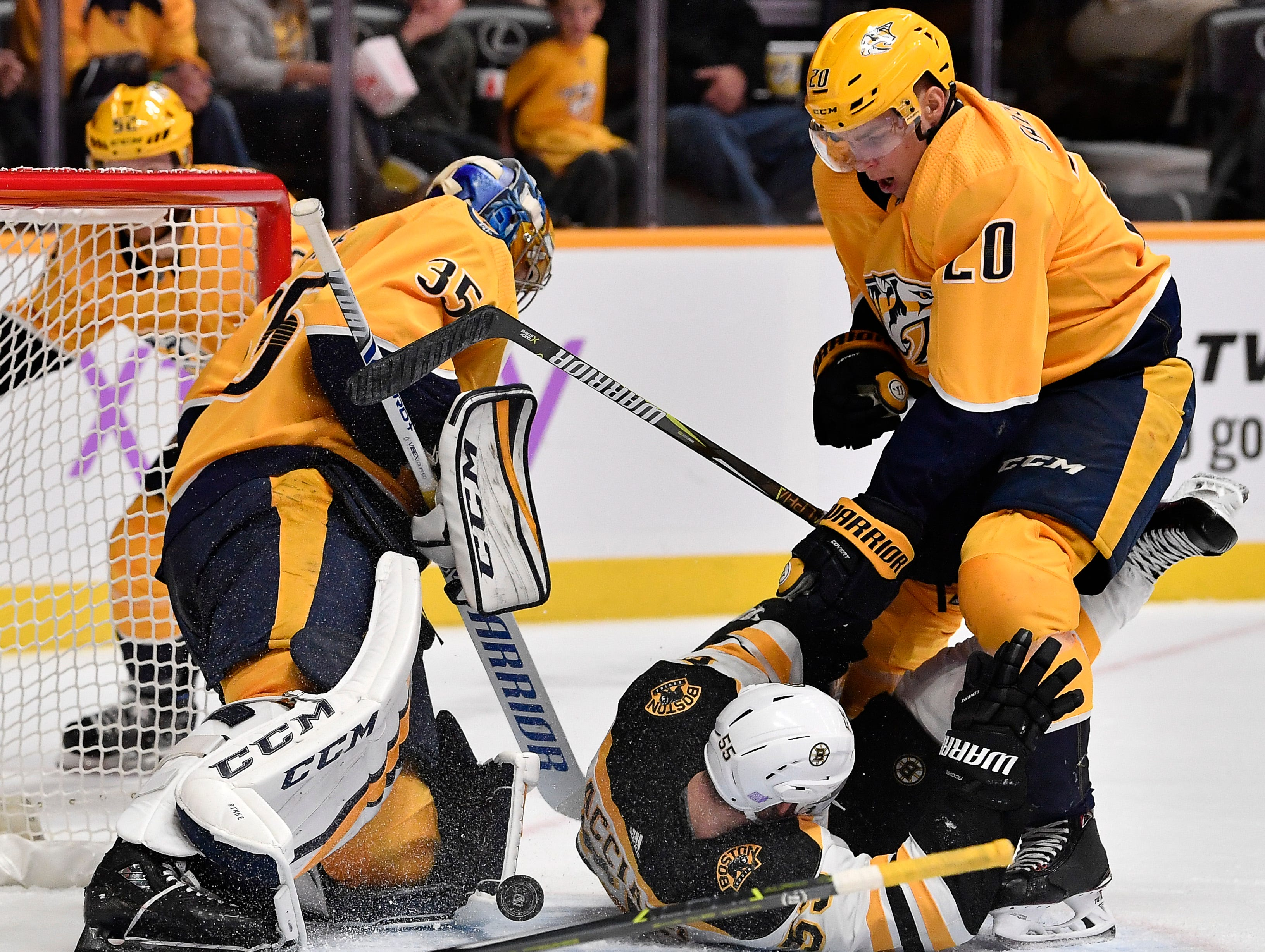 Predators goaltender Pekka Rinne (35) and right wing Miikka Salomaki (20) defend the goal and stop the puck as Bruins center Noel Acciari (55) tries to score during the second period at Bridgestone Arena Saturday, Nov. 3, 2018, in Nashville, Tenn.