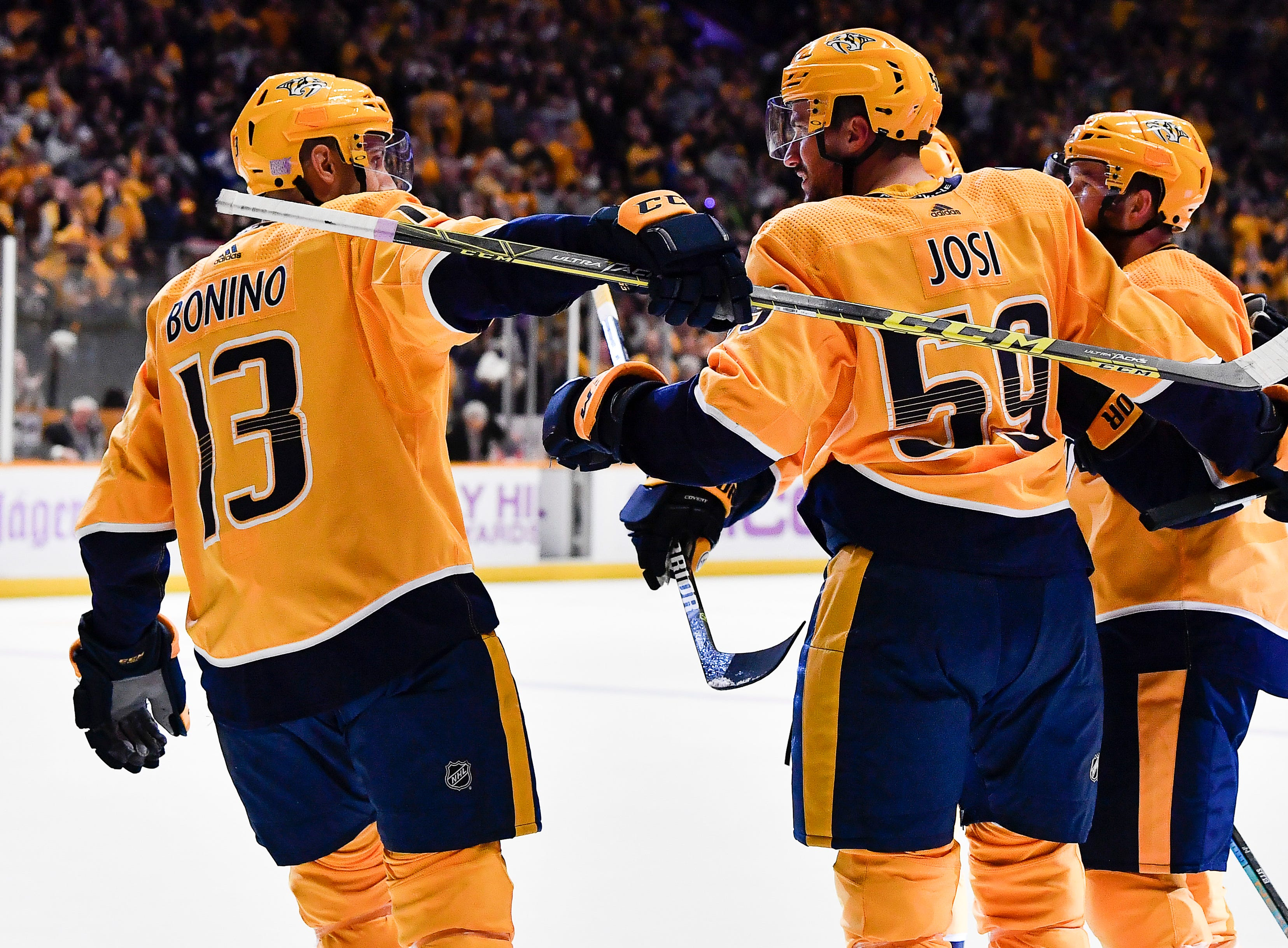Predators defenseman Roman Josi (59) is congratulated by teammates after his goal during the first period against the Bruins at Bridgestone Arena Saturday, Nov. 3, 2018, in Nashville, Tenn.
