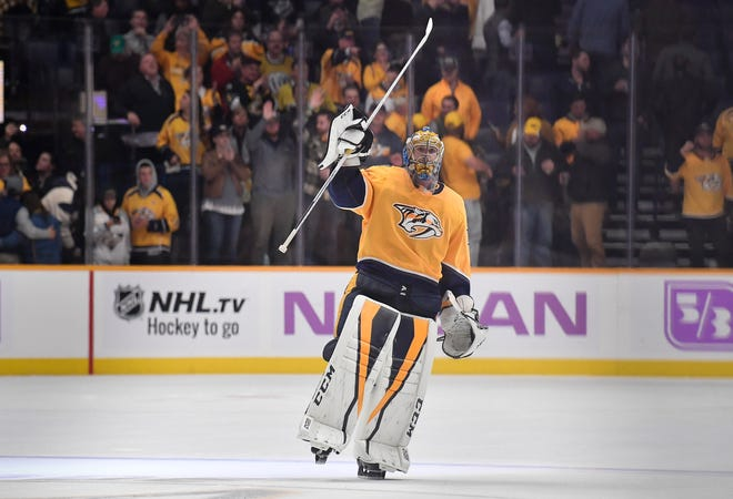 Goaltender Pekka Rinne salutes the crowd after the Predators' 1-0 win over the Bruins on Saturday at Bridgestone Arena.