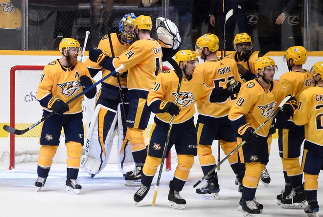 Predators goaltender Pekka Rinne (35) is congratulated by teammates after his 1-0 win over the Bruins on Nov. 3.