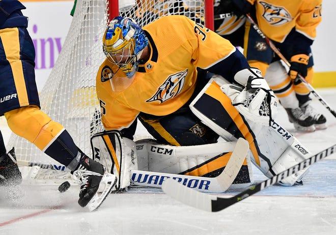Predators goaltender Pekka Rinne (35) blocks a Bruins shot Saturday.