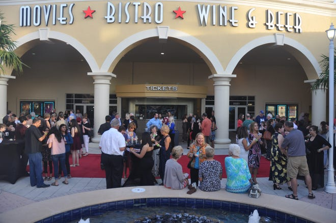 The night began with a walk down the red carpet, hors d'oeuvres and champagne in front of the Prado Stadium 12 theater