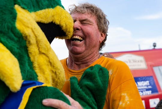 Bobby Williams and Swamp Buggy Race mascot, Swampy, share a moment after the Williams big win at the 70th anniversary Swamp Buggy Races on Sunday evening at Florida Sports Park.