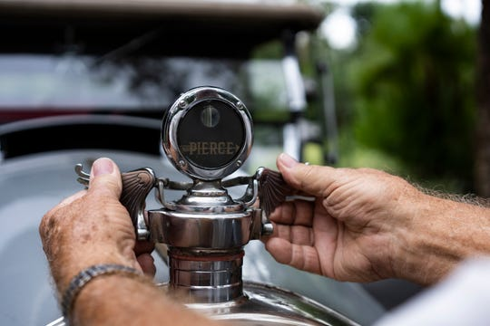 The owner of a 1925 Pierce-Arrow, Wayne Hancock, shows off the one-of-a-kind Pierce-Arrow radiator stone guard in Naples on Sunday, Nov 4, 2018 at the Naples Wilderness Country Club.