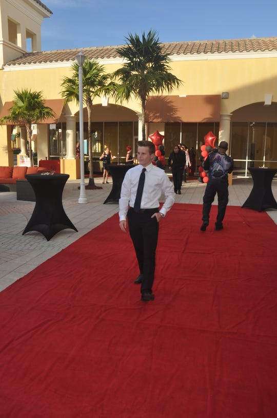 Filmmakers walked the red carpet Thursday night in front of the Prado Stadium 12 theater.