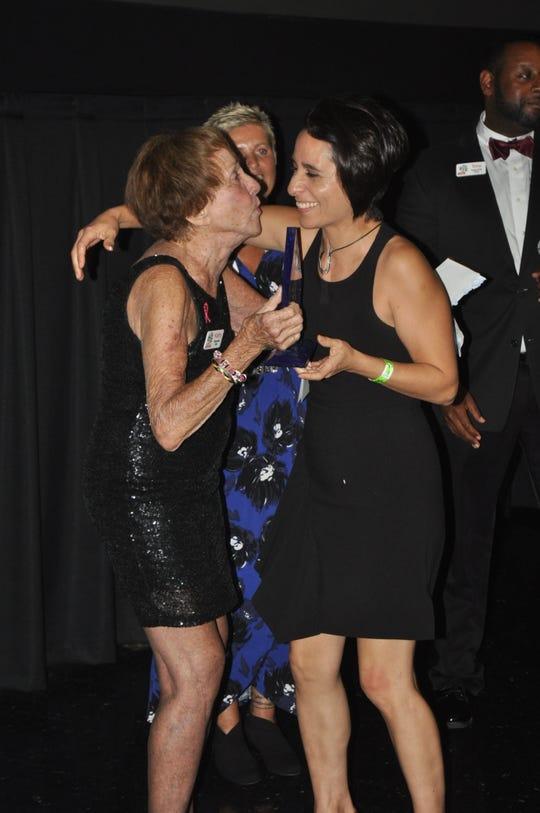 Kathy McGrath congratulates the winner of the best love story film.