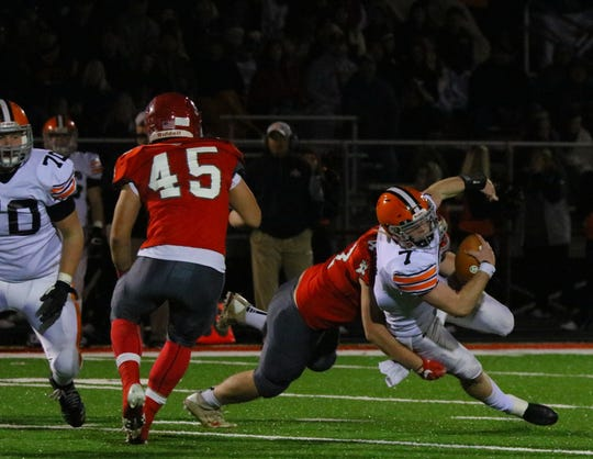 Johnstown's Josh Boso sacks Ironton's Gage Salyers during Saturday's Division V, Region 19 quarterfinal. Boso is a First Team selection for the 2018 All-Advocate Football Team.
