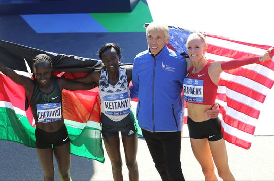 Second place finisher, Vivian Cheruiyot, of Kenya, first place finisher, Mary Keitany, of Kenya, Race Director, Peter Ciaccia and third place finisher Shalane Flanagan, of the USA, are shown by the finish line. Sunday, November 4, 2018
