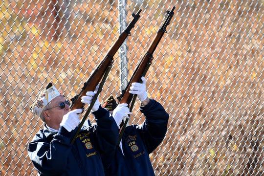 Veterans John Huehemann, 78, and Gunter Kuprat, 83, of VFW Post 3149 in Carlstadt fire off a salute.