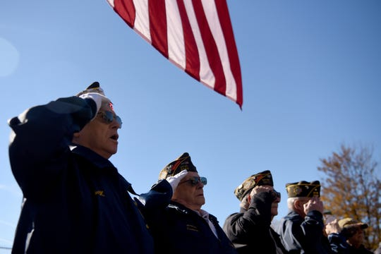 The veterans stand at attention during the presentation of colors.