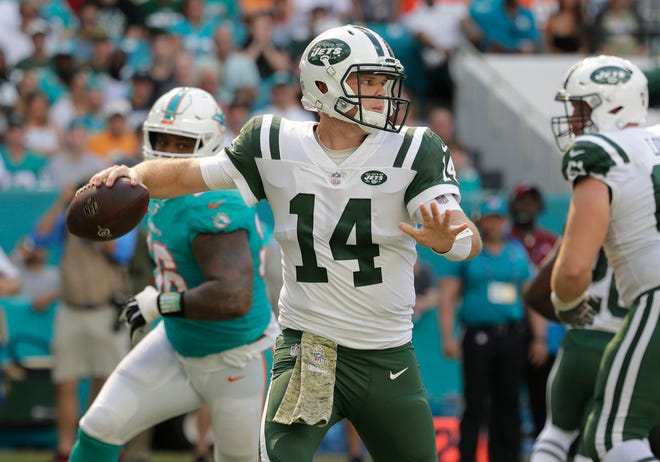 New York Jets quarterback Sam Darnold (14) looks to pass, during the first half of an NFL football game against the Miami Dolphins, Sunday, Nov. 4, 2018, in Miami Gardens, Fla. (AP Photo/Lynne Sladky)