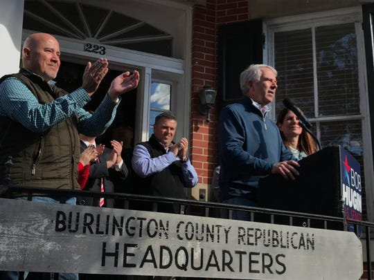 Senate candidate Bob Hugin urges supporters in Mount Holly on Nov. 3, 2018 to go out and vote as Rep. Tom MacArthur, left, applauds.