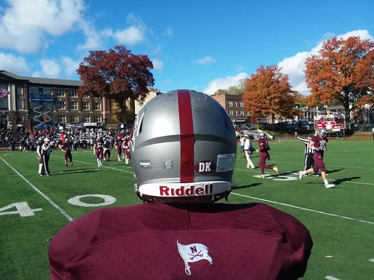 Nutley players wore a decal on their helmet honoring the late Donny Klein, a former football assistant coach who died in an automobile accident last month.