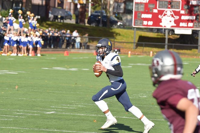 Belleville quarterback Matthew LaTorre rolling out to throw a pass during game at Nutley on Nov. 3. LaTorre played an excellent game for the Bucs, throwing a pair of touchdown passes.