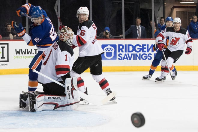 New Jersey Devils goaltender Keith Kinkaid (1) and defenseman Andy Greene (6) defend the net against New York Islanders left wing Anders Lee (27) during the second period of an NHL hockey game, Saturday, Nov. 3, 2018, in New York.
