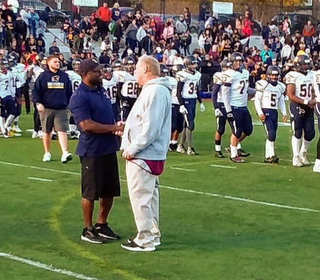 Belleville coach Jermain Johnson (left) greeting Nutley coach Steve DiGregorio after a well-played game.