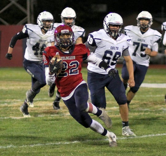 Junior Wildcat back (22) Ceazar Chavez could not be contained last Friday night by the Silver High Fighting Colts' defense. Chavez score three touchdowns and threw for another while rushing over the century mark in all three district games.