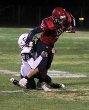 Junior Wildcat Israel Reyes (7) attempted to break free from a defender following a short pass reception.