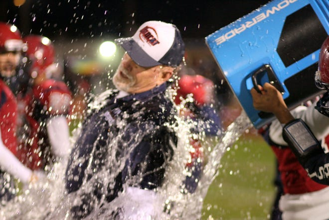 Deming High Head Coach Greg Simmons was given the ceremonial bath following Deming's 49-35 victory over the Silver High Fighting Colts. Simmons has led the 'Cats to consecutive District 3-5A football championships.