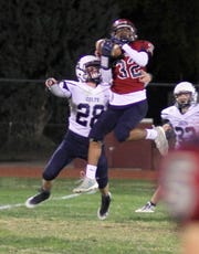 Sophomore Jordan Caballero (32) pulled in this 42-yard reception to put the Wildcats in scoring position.