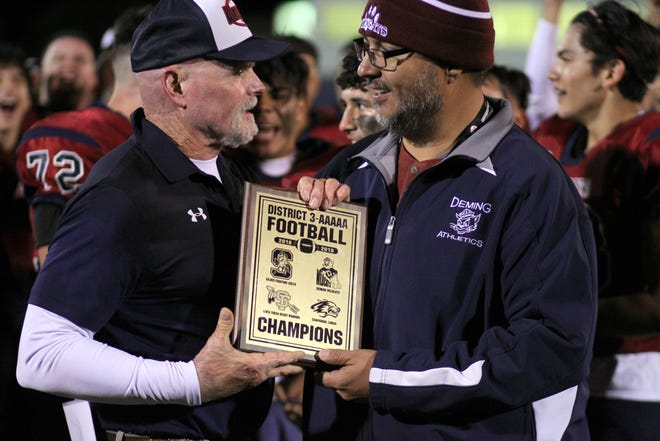 Deming High School Athletic/Activities Director Bernie Chavez (right) presented Wildcat head coach Greg Simmons with the team's second straight District 3-5A Football Championship Plaque.