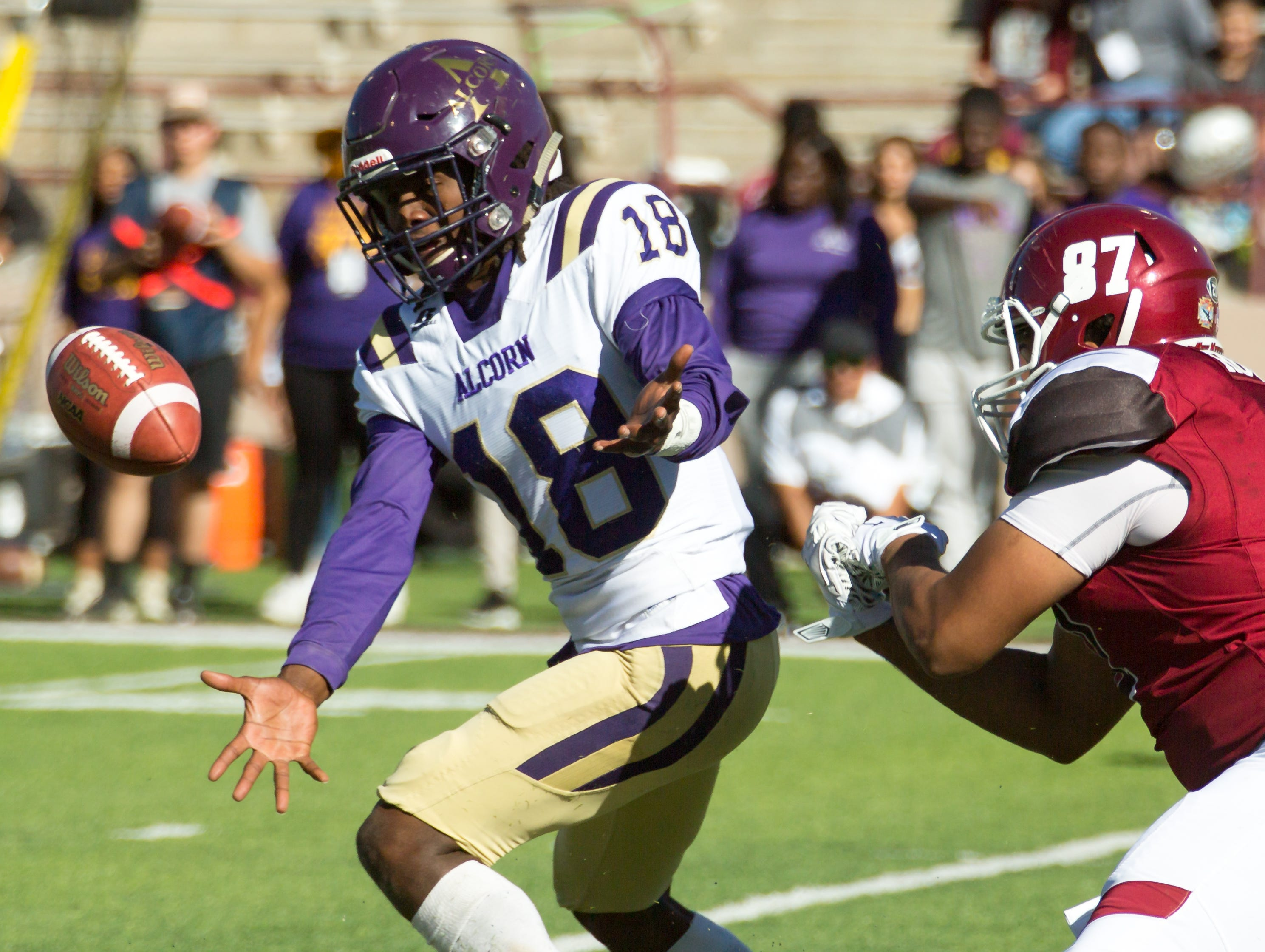 Alcorn State's Leishaun Ealey misses the ball as NMSU's Bryce Roberts is near by on Saturday, Nov. 3, 2018 at Aggie Memorial Stadium.