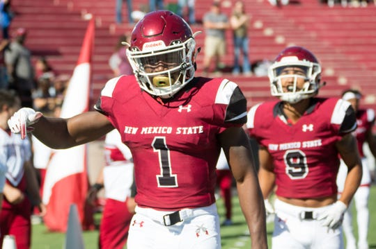 NMSU's Jason Huntley, reacts after scoring a touchdown on a kickoff return to put the Aggies up 7-0 on Saturday, Nov. 3, 2018 at Aggie Memorial Stadium against Alcorn State.