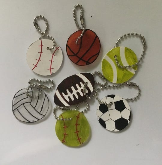 Sports key chains made by Arabella Camunez and sold at Shrinky Chains.