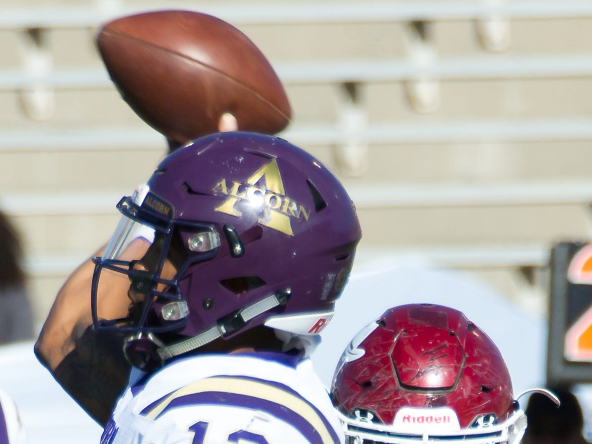 NMSU's Cedric Wilcots II works for a sack as Alcorn State University quarterback Noah Johnson prepare to release the ball on Saturday, Nov. 3, 2018 at Aggie Memorial Stadium.
