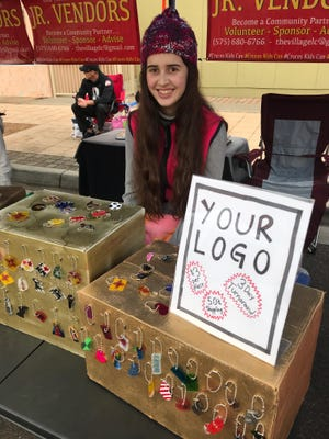 Las Cruces Farmers and Crafts Market Jr. Vendor Arabella Camunez, 14, owns Shrinky Chains.