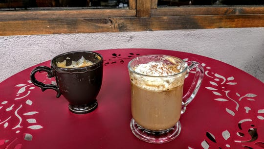 The Peppermint Mocha, left, and the Lavender Vanilla Mocha  garnished with whipped cream and cocoa powder, at Moms Coffee.
