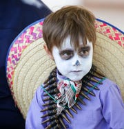Atlas Gaytan, 5, is dresses for Dia de los Muertos on Sunday, Nov. 4, 2018, at the Mesilla Plaza.