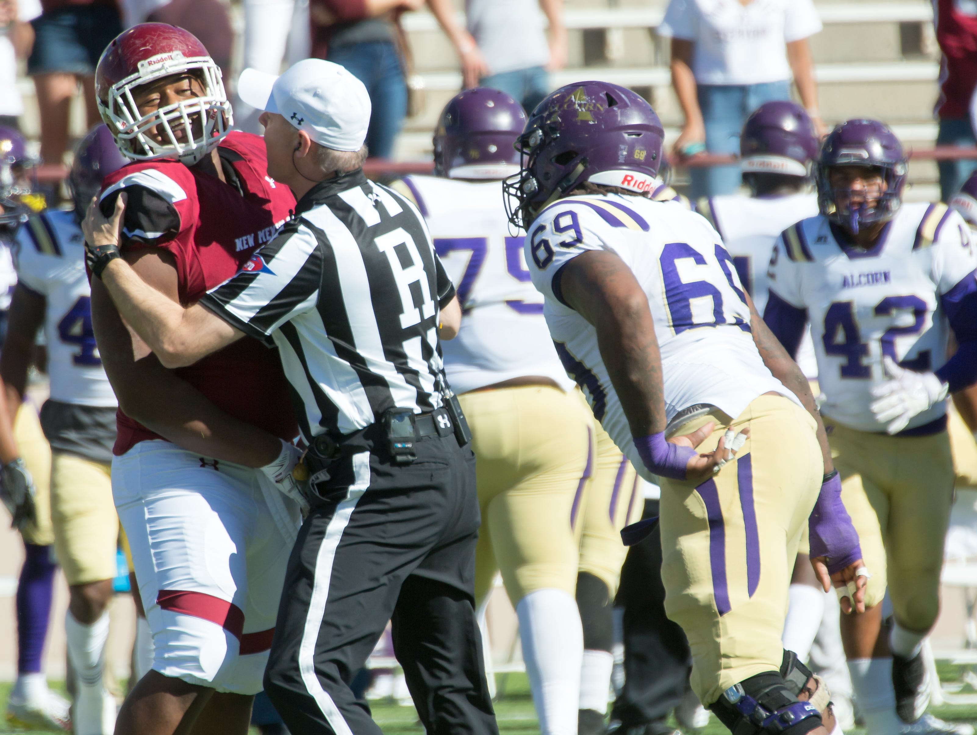 NMSU's Miles Vigne gets a scolding from a referee as Alcorn State player Deonte Brooks looks for more on Saturday, Nov. 3, 2018 at Aggie Memorial Stadium.