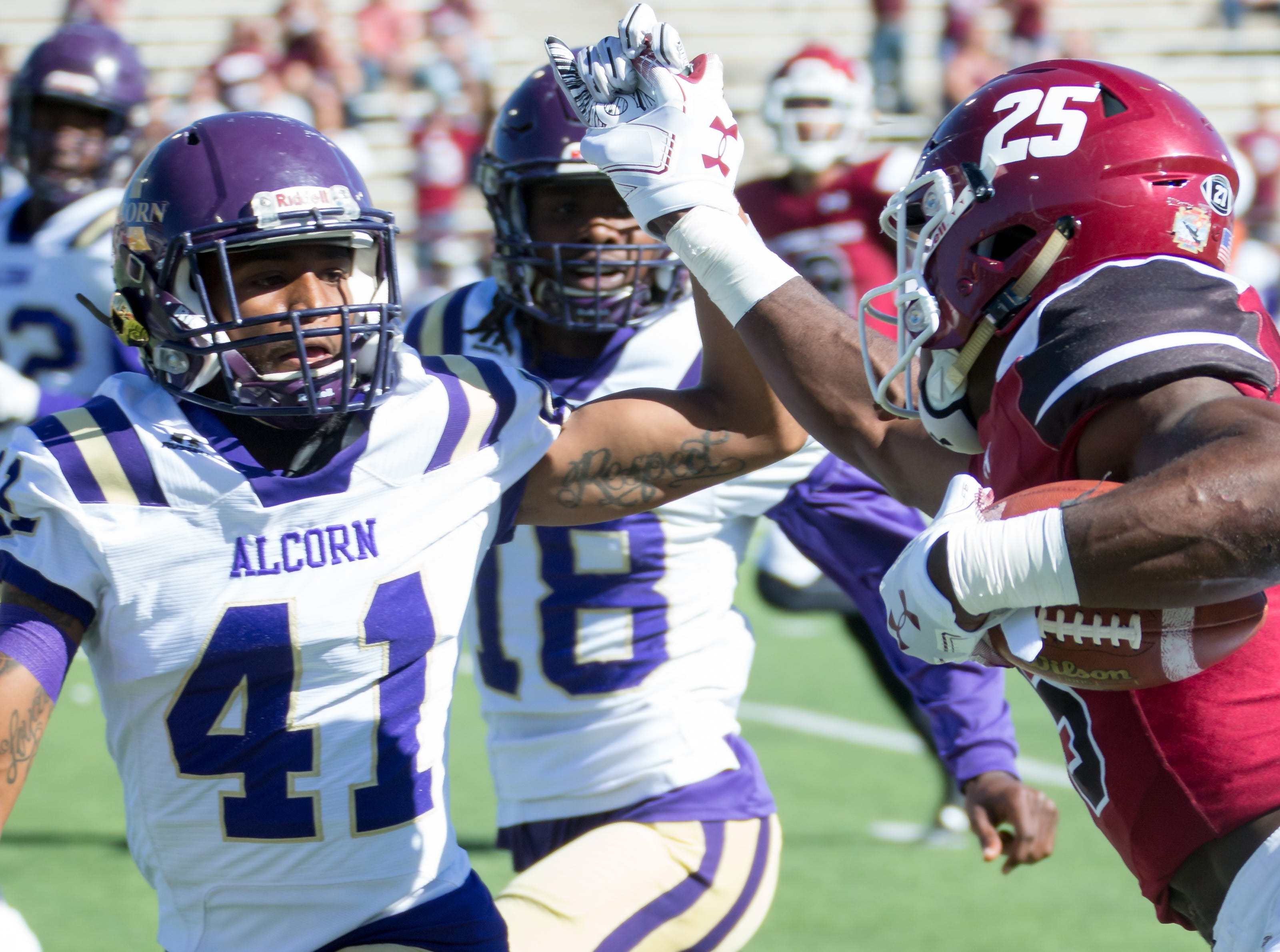 NMSU's Christian Gibson trys to keep Alcorn State player Jalen Thomas away on Saturday, Nov. 3, 2018 at Aggie Memorial Stadium.