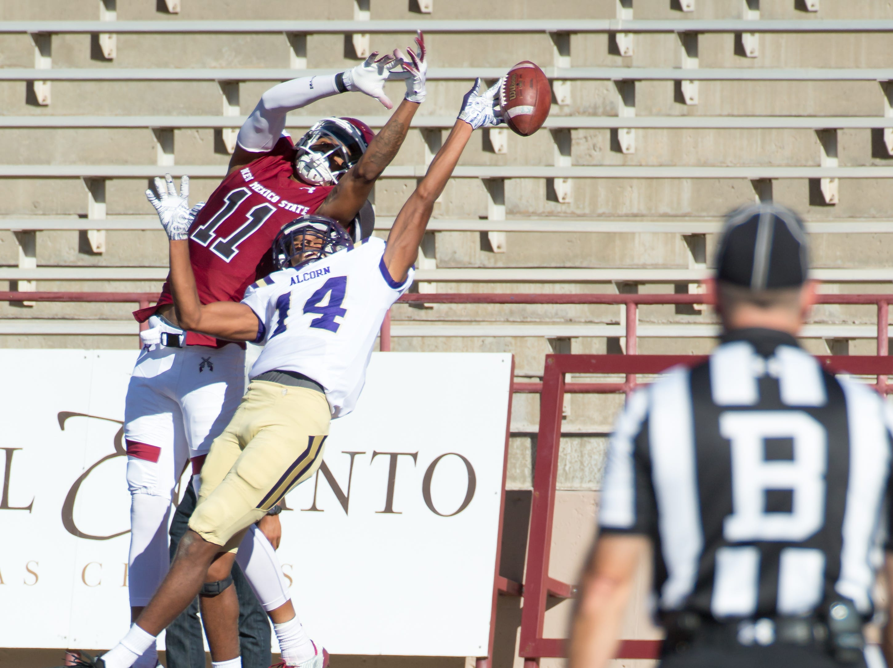 NMSU Shea Holebrook Jr. misses a pass in the endzone as Alcorn State's Calyontay Key does the same on Saturday, Nov. 3, 2018 at Aggie Memorial Stadium.