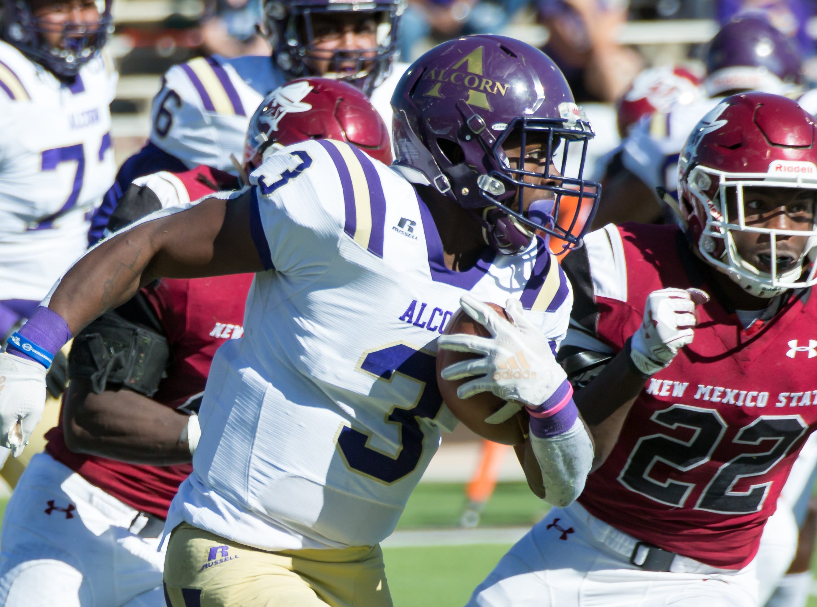 Alcorn State's De'Shawn Waller looks for yards while his NMSU oppponents are near by on Saturday, Nov. 3, 2018 at Aggie Memorial Stadium,